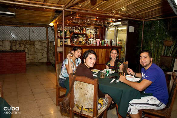 people eating at a restaurant © Cuba Absolutely, 2014