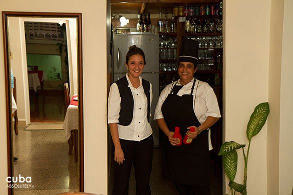 2 waiters wearing their balck and white uniforms © Cuba Absolutely, 2014