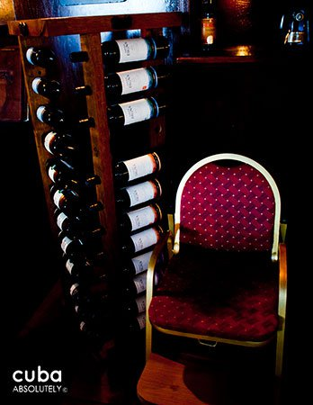 red chair next to different kinds of wines © Cuba Absolutely, 2014