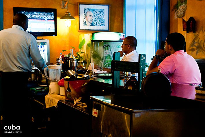 3 men watching sport at a bar © Cuba Absolutely, 2014