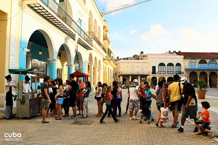 people buying icecream at Old square in old havana© Cuba Absolutely, 2014