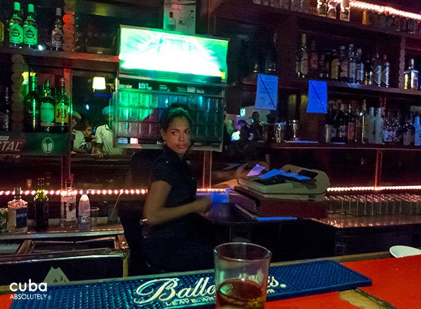 girl behind the bar in Centro Vasco club in Vedado© Cuba Absolutely, 2014