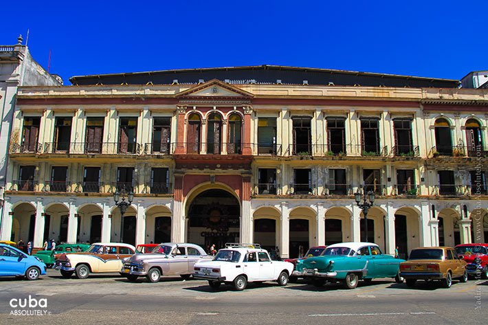 Sport center Kid Chocolate in Old Havana with cars parking in front  © Cuba Absolutely, 2014