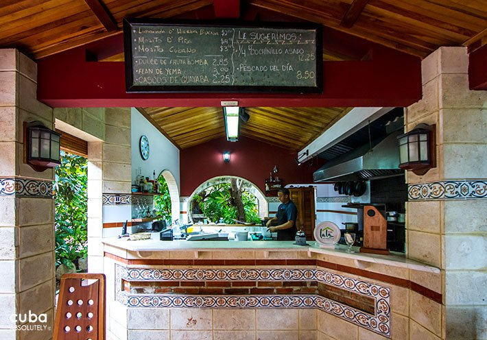 Lala restaurant in Vedado, open kitchen with the menu up in a board © Cuba Absolutely, 2014