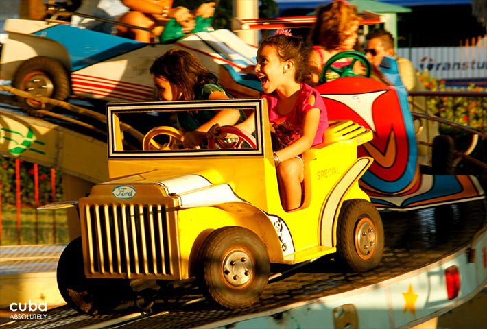Kids on a small yellow car in Coney Island park in Miramar © Cuba Absolutely, 2014