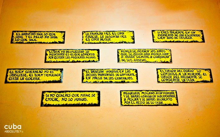 Popular saying on a yellow wall © Cuba Absolutely, 2014
