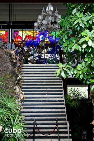 Big stair with a stained-glass window at the end © Cuba Absolutely, 2014