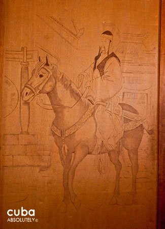 Sketch of a chinese man on a horse in a wood wall © Cuba Absolutely, 2014
