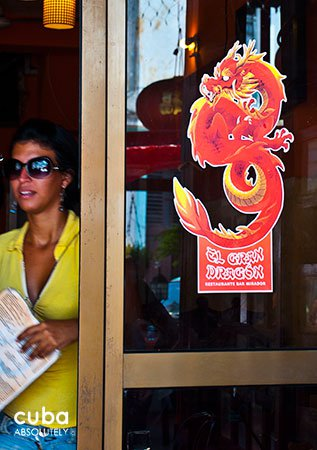 Girl getting out El Gran Dragon, chinese restaurant in Old Havana © Cuba Absolutely, 2014