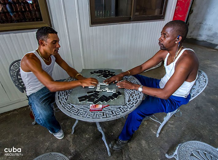 Craft fair in Old Havana, 2 men playing domino © Cuba Absolutely, 2014
