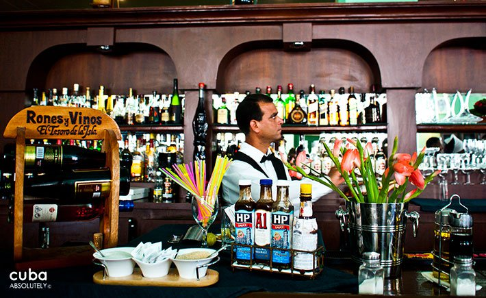 Barman making a drink in a restaurant © Cuba Absolutely, 2014