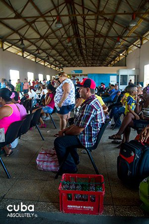 People sitting on the Train and bus station La coubre in Old Havana © Cuba Absolutely, 2014