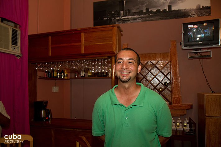 Man with a green tshirt smiling © Cuba Absolutely, 2014