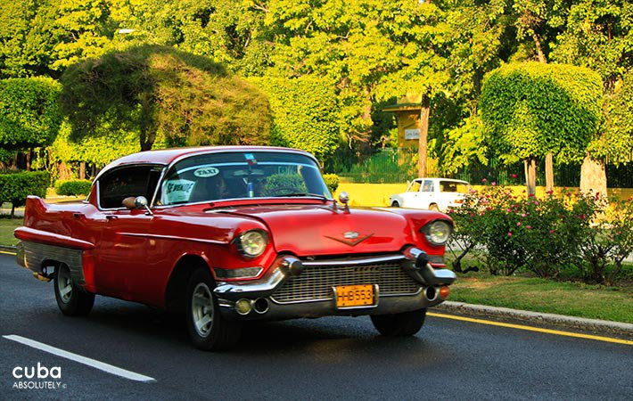 5th avenue in Miramar, red old car © Cuba Absolutely, 2014