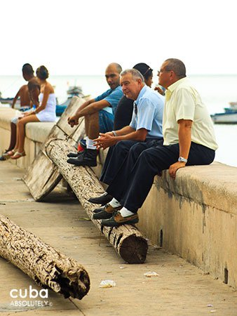 group of old men sitting on seawall © Cuba Absolutely, 2014