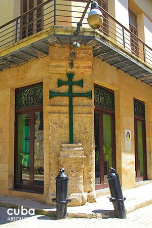 green cross on a yellow old building in a corner© Cuba Absolutely, 2014