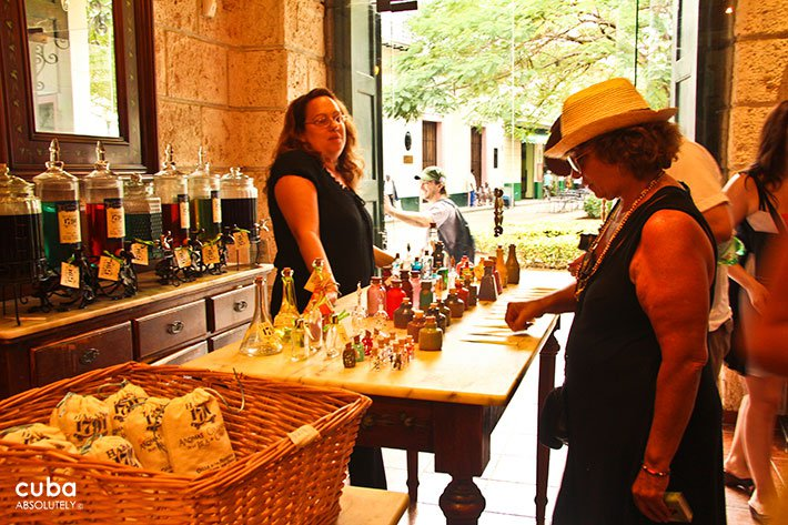 woman buying at Perfume shop in old havana© Cuba Absolutely, 2014