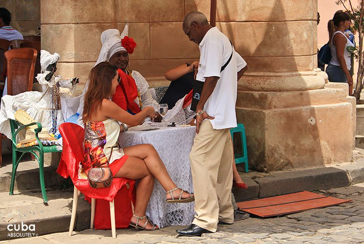 lady reading carts at Cathedral Square in old havana© Cuba Absolutely, 2014