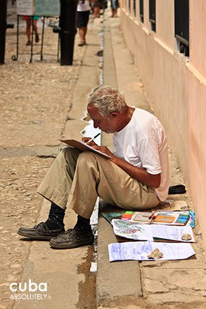 old man writing at Cathedral Square in old havana© Cuba Absolutely, 2014