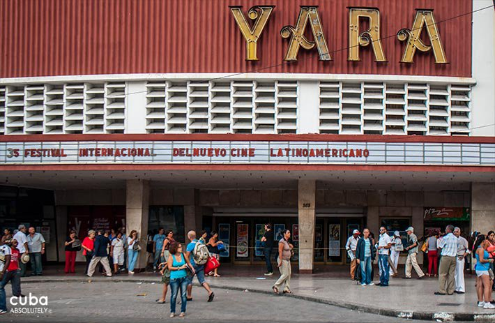 Yara cinema in Vedado painted in red with a big sign © Cuba Absolutely, 2014 - 2020