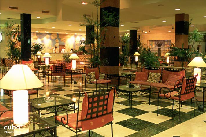Occidental Miramar hotel, restaurant with red chairs   © Cuba Absolutely, 2014 - 2020