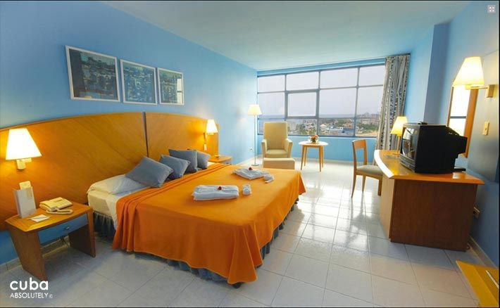 Panorama hotel in Miramar, blue room with yellow bed © Cuba Absolutely, 2014 - 2020