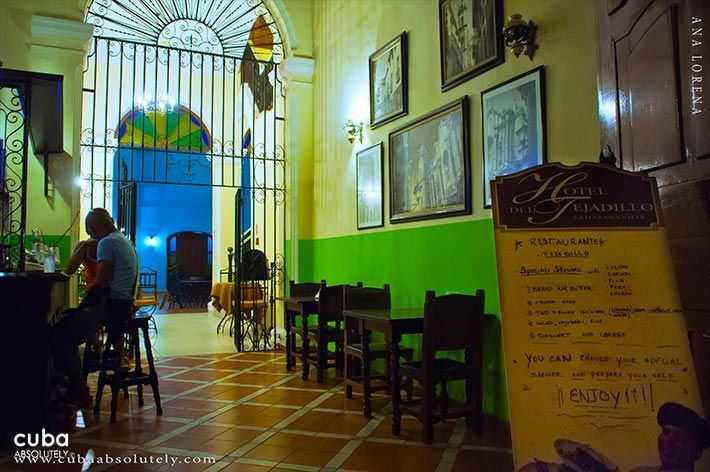 Tejadillo hotel in Old Havana, bar San Carlos with wood chairs © Cuba Absolutely, 2014 - 2020