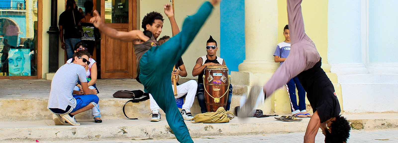 Two boys practicing Capoeira