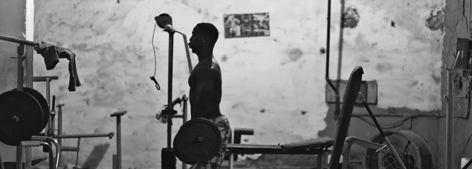 Man doing weights on a gym