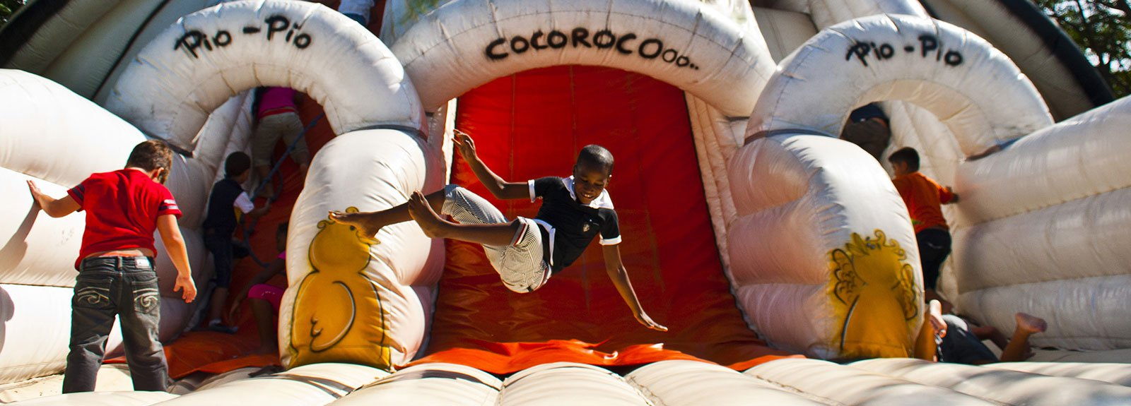 Kids jumping on an inflatable game