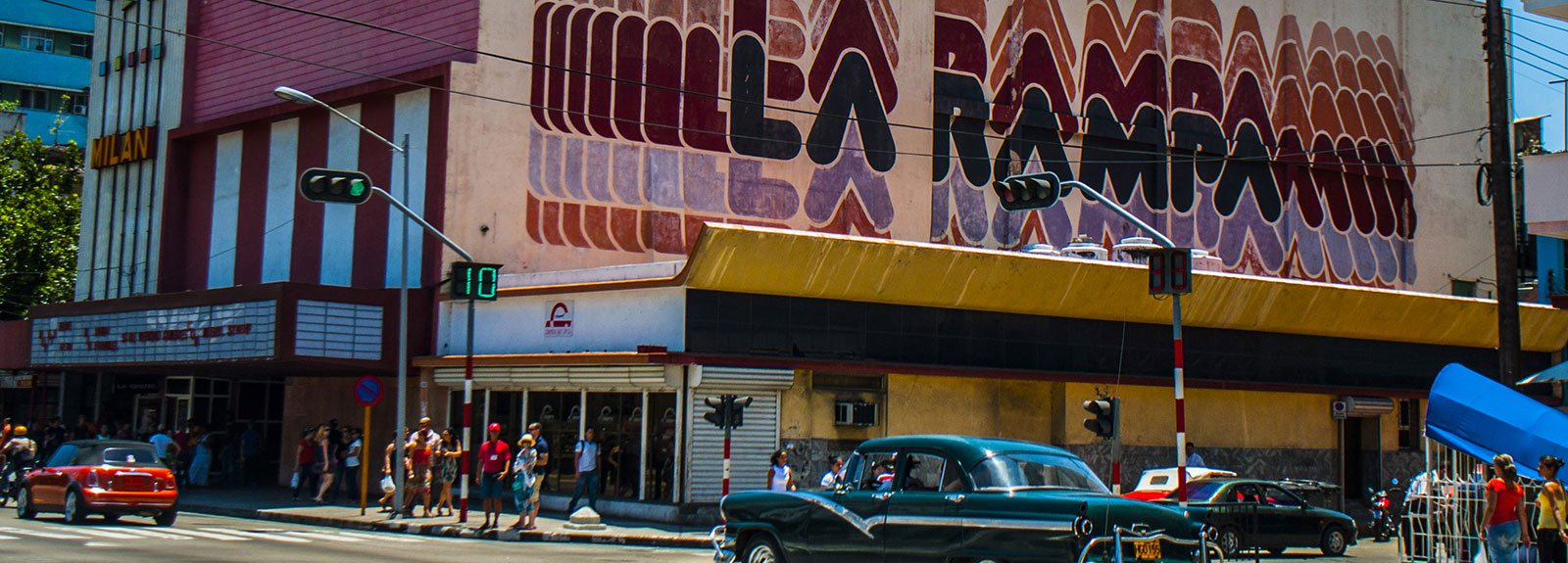 Black old car passing in front of La Rampa