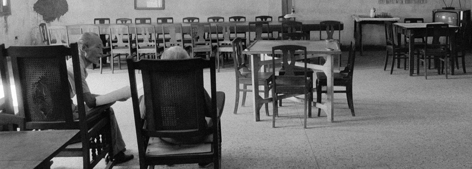 Room with chairs and people seat, black and white picture