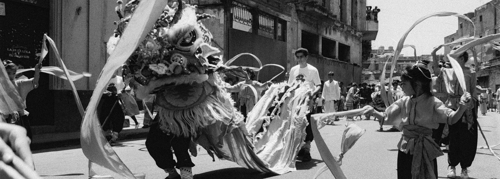 Chinatown, parade with dragons and marcial arts , black and white picture