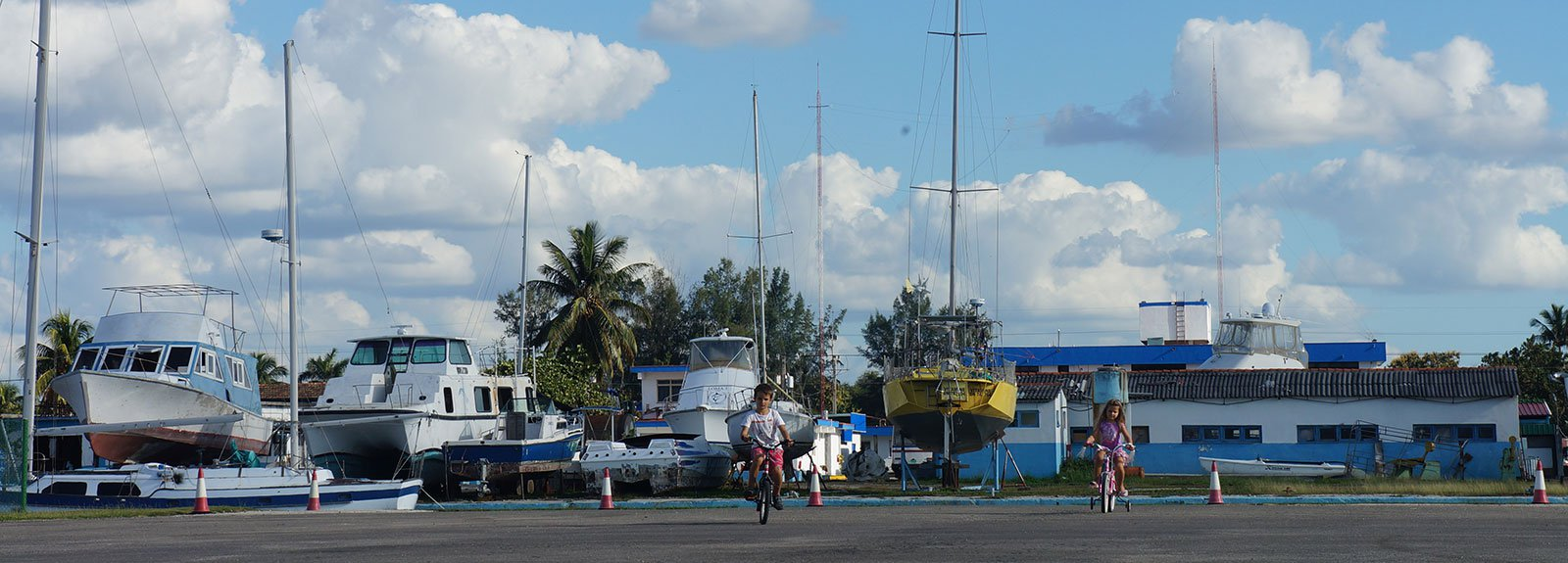 2 kid riding bicycle on Marina Hemingway
