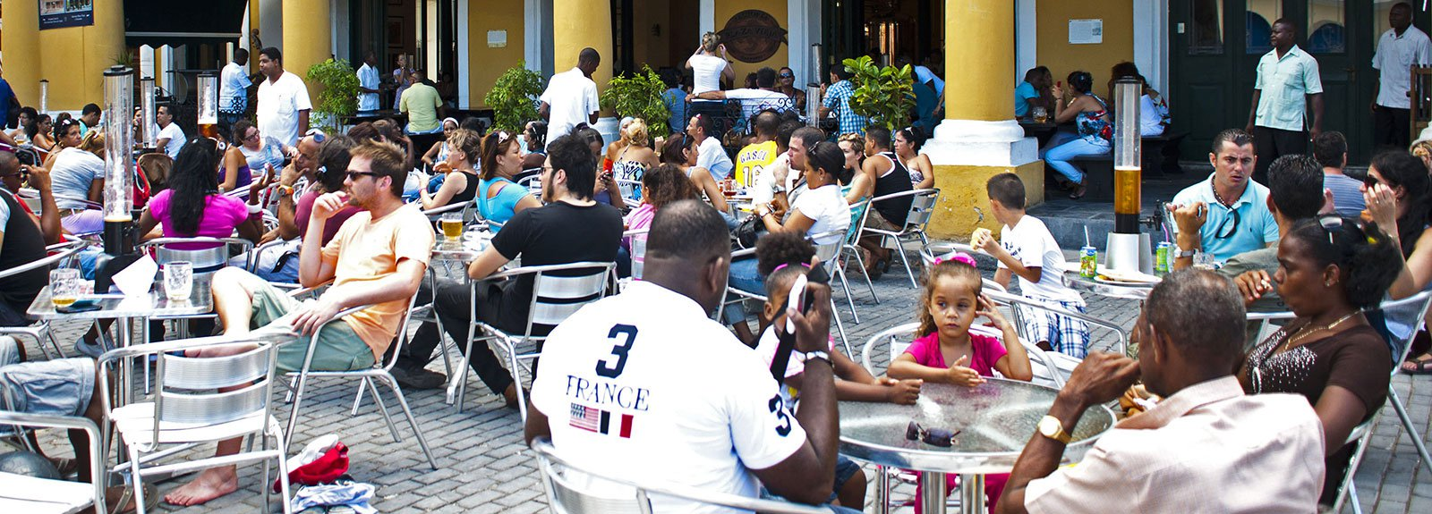 Factoria Plaza Vieja restaurant  in Old Havana, people drinking beer and eating, spanish tavern decoration
