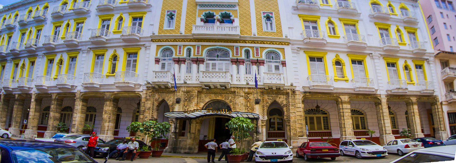 Sevilla hotel front in white and yellow
