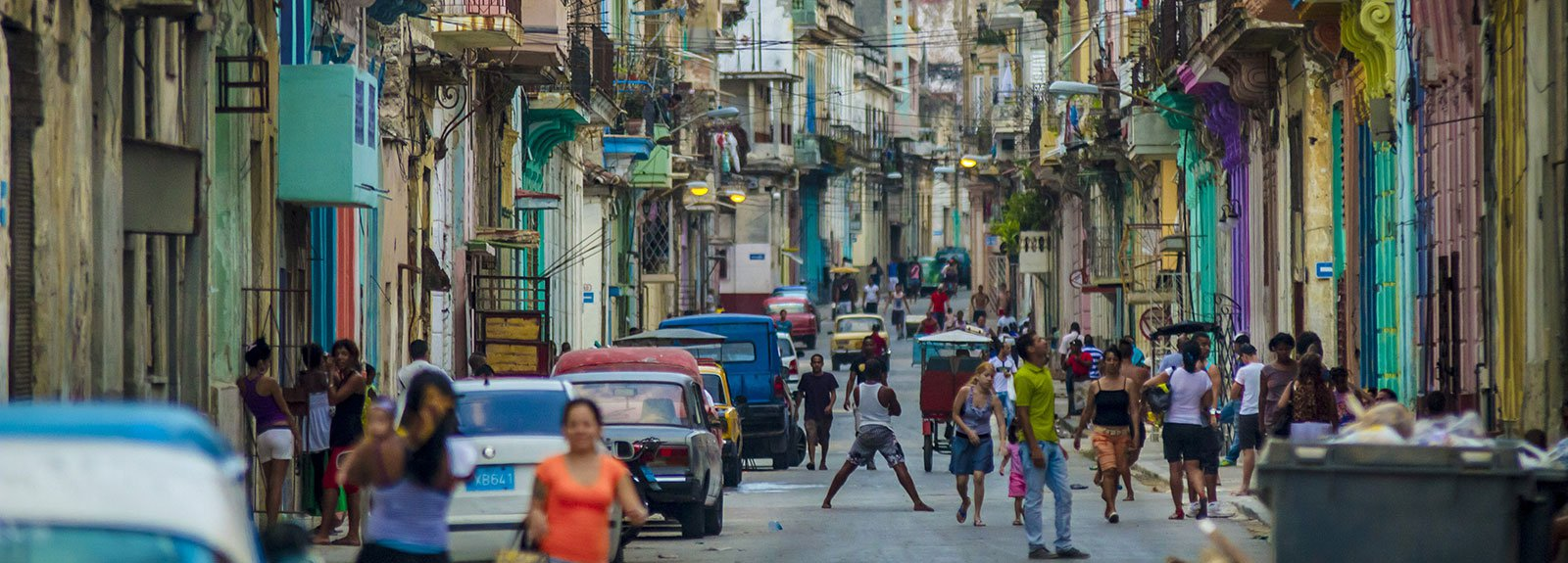 Street in Old Havana with kids playing and people walking