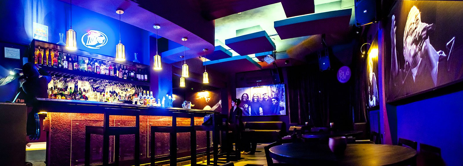 Prive Lounge, black wood and blue walls
