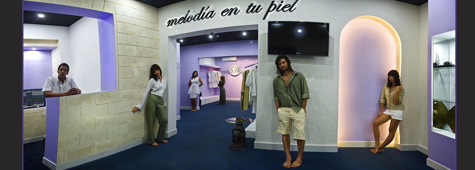 Models in a shop painted in white and violet