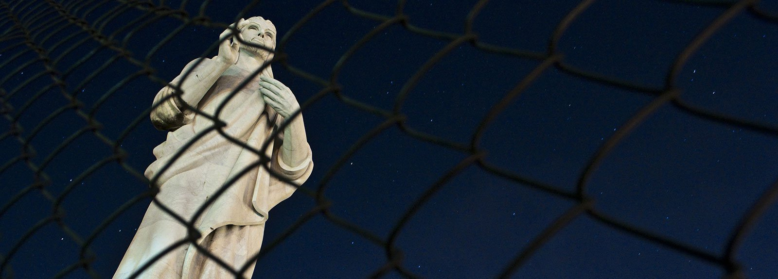 Statue of Jesus behind bars on Casablanca