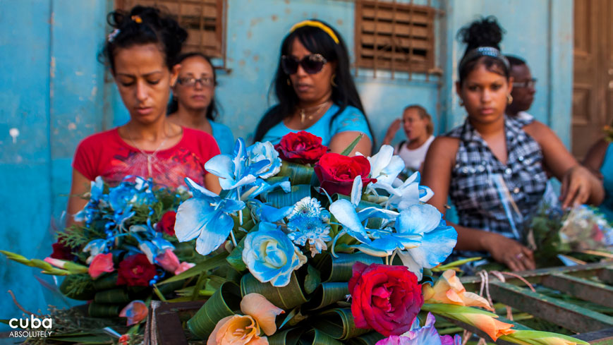 Buying flowers for Our Lady of Regla, syncretized with Yemaya in Santeria. Havana, Cuba
