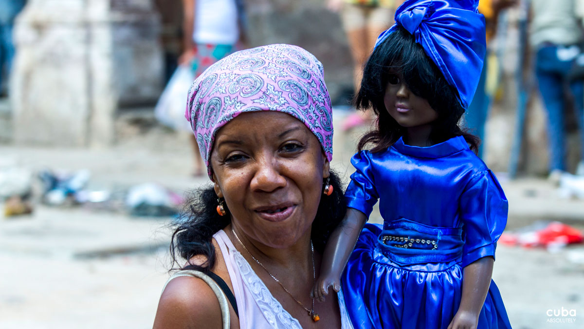 A doll in a blue and silver dress and turban represents Our Lady of Regls, who presides over the church of the fishing village of Regla, on the eastern shore of Havana harbor. Havana, Cuba