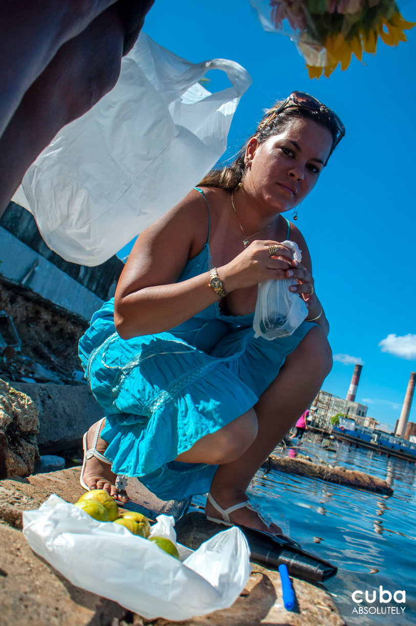 Fruits and flowers are offered to Yemaya in exchange for her protection. Havana, Cuba