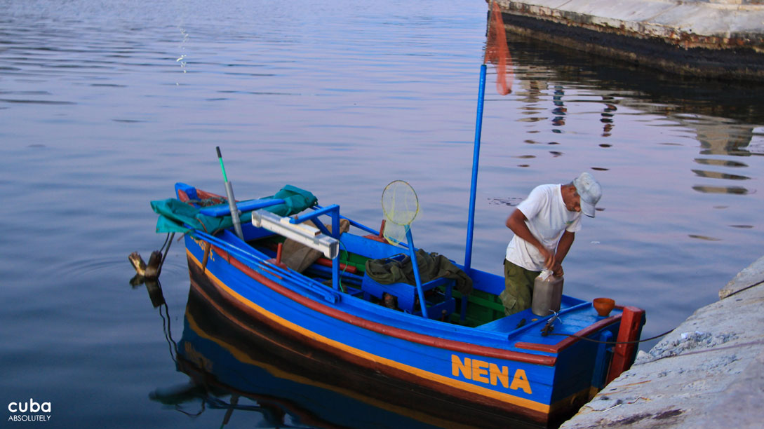 Fishing boats leava Havana's Malecón every afternoon into the deep blue waters of the Atlantic. Havana, Cuba