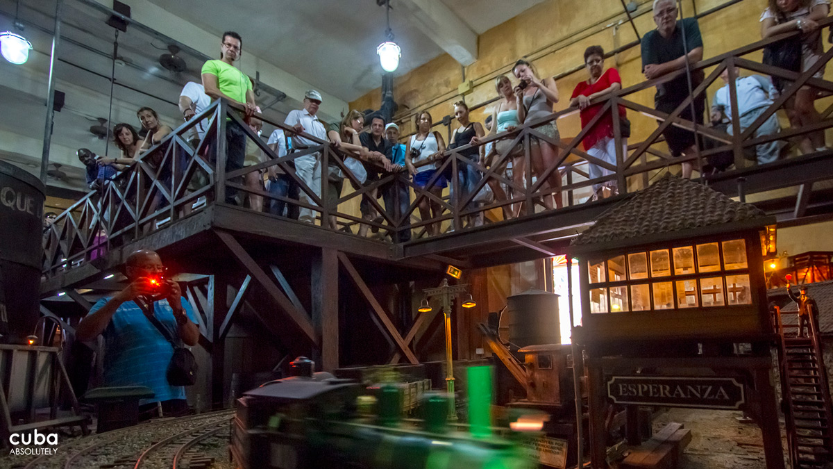 While visitors look at exhibits, the guide explains how Columbus first brought sugarcane stalks from the Canary Islands during his second trip to the Americas, initially to Hispaniola (today's Dominican Republic and Haiti) and then to other regions in the Americas. Havana, Cuba