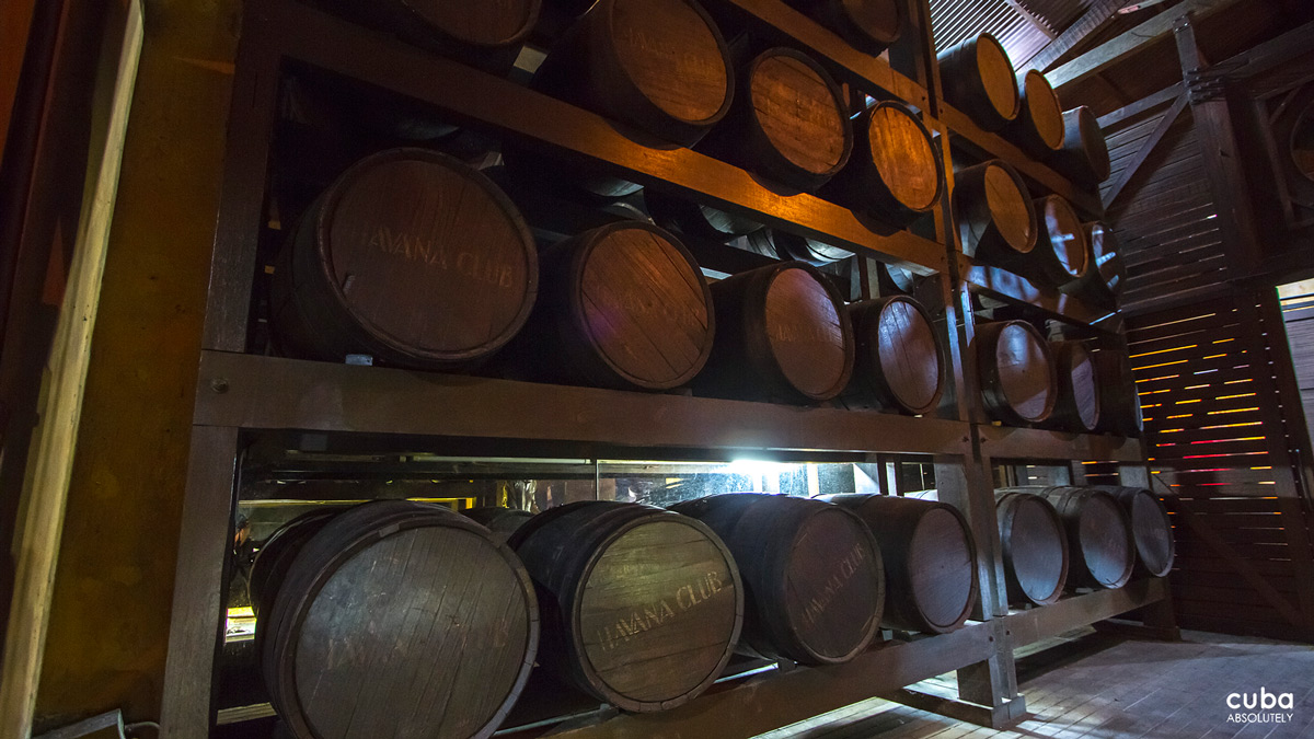 The museum has a half lighted warehouse where rum and aguardiente are aged under the zealous care of master rum makers. Havana, Cuba
