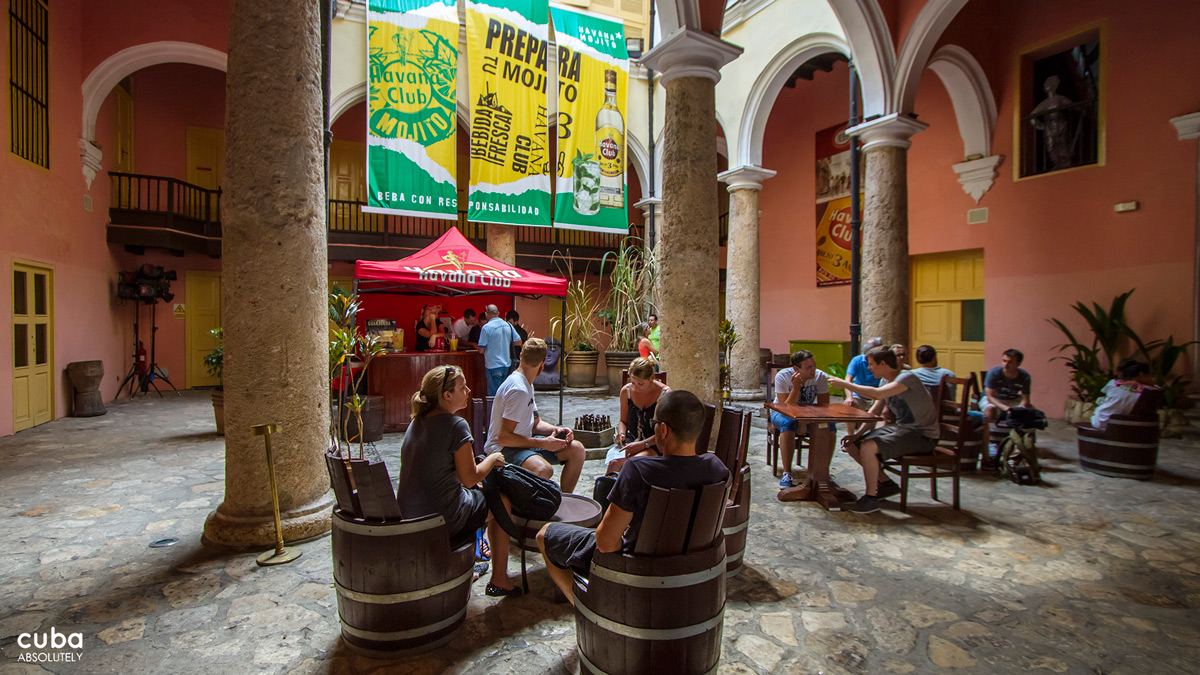 Visitors walk down the stairs on the other side of the museum down to a narrow bar with an exhibition of different rum labels, stones used for their printing, and other artefacts related to the world of rum. Havana, Cuba