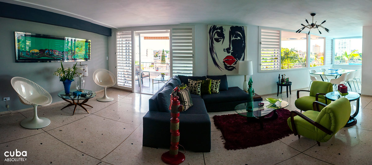 Artedel is a is a super-shiny 1950s style home scattered with contemporary furniture, Murano glass pieces, bronze lamps, and vibrant art work. Havana, Cuba