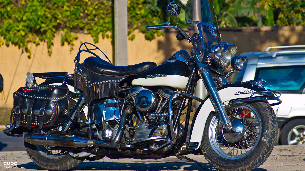 "Harley Davidson morocycles or ""Harleys"" are manufactured by Harley Davidson Inc., an American motorcycle manufacturer. Harley Davidson Inc. is one of the major American manufacturers that survived the Great Depression and competition from Japanese manufacturers. Havana, Cuba"