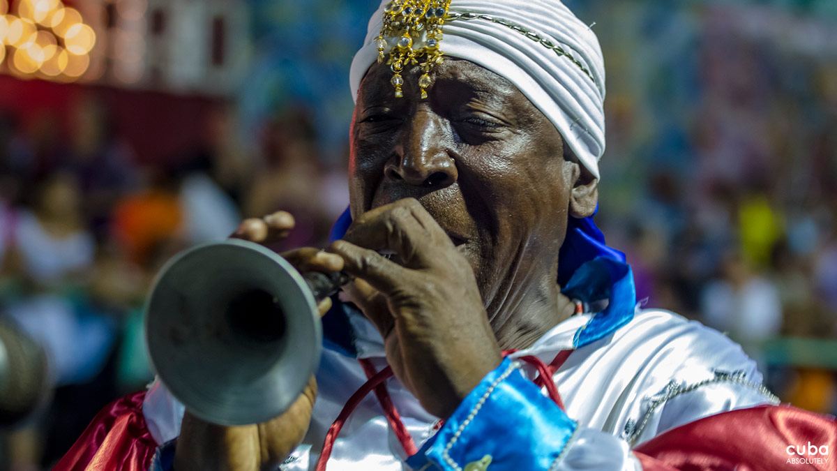 During the days of July, all the inhabitants of the city move to the contagious rhythm of the conga drums, the piercing shriek of the Chinese cornet and the dozens of improvised percussion instruments--oil drums, pots, tires, pans, spoons… Santiago de Cuba, Cuba
